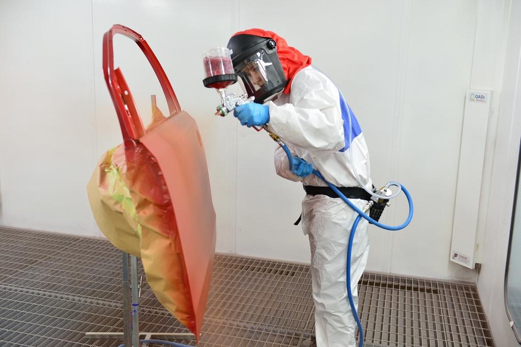 Spray painting a car